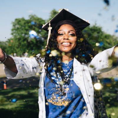 graduate throwing confetti