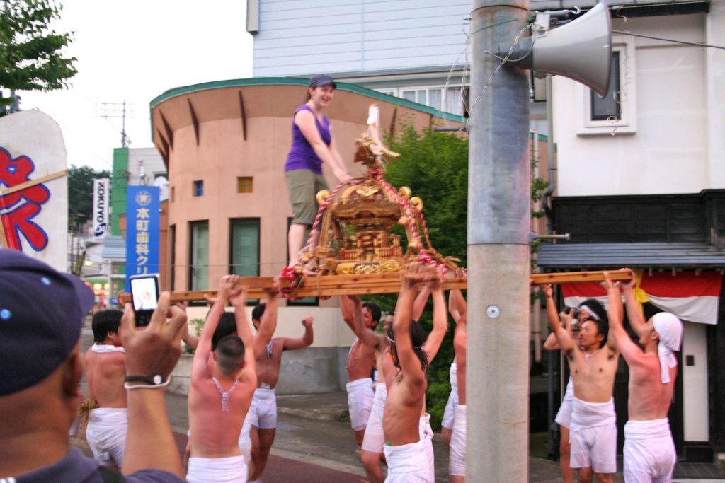 Rachel Drummond getting hoisted at a Japanese summer festival